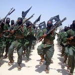 A photo from Feb. 17, 2011 shows al-Shabab fighters marching with their weapons during military exercises on the outskirts of Mogadishu, Somalia.