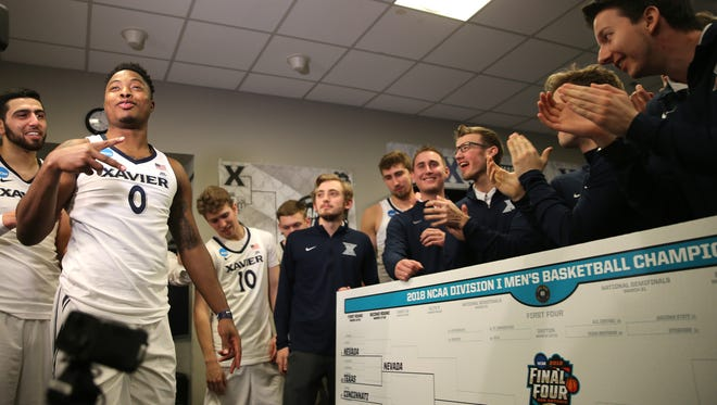 Xavier Musketeers forward Tyrique Jones (0) gestures after placing the team's name on the bracket after the first-round NCAA Tournament game.