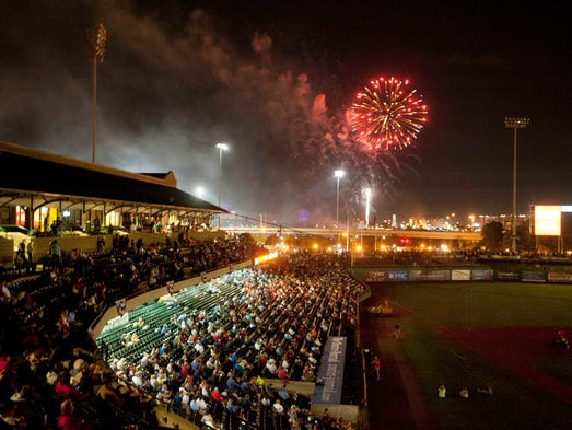 Fans at Louisville Slugger Field enjoy fireworks after the Louisville Bats game. 03 July 2014