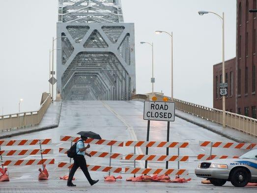 Barricades block the entrance to the Clark Memorial Bridge in Louisville. July 8, 2014
