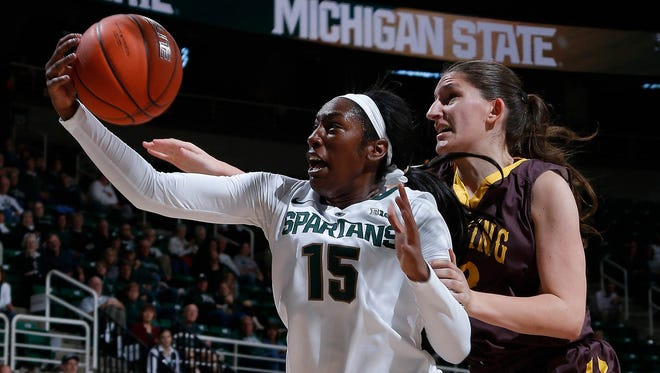 Michigan State's Victoria Gains, left, grabs a rebound against Wyoming's Marta Gomez Sunday, Nov. 13, 2016, in East Lansing, Mich. Michigan State won 63-51.