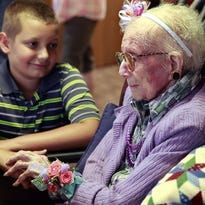 Viola Jacobi sits with her great-great-grandson, Andrew Donlon, 11, at a party marking her 112th birthday last July. Viola died Sunday two months shy of her 113th birthday.