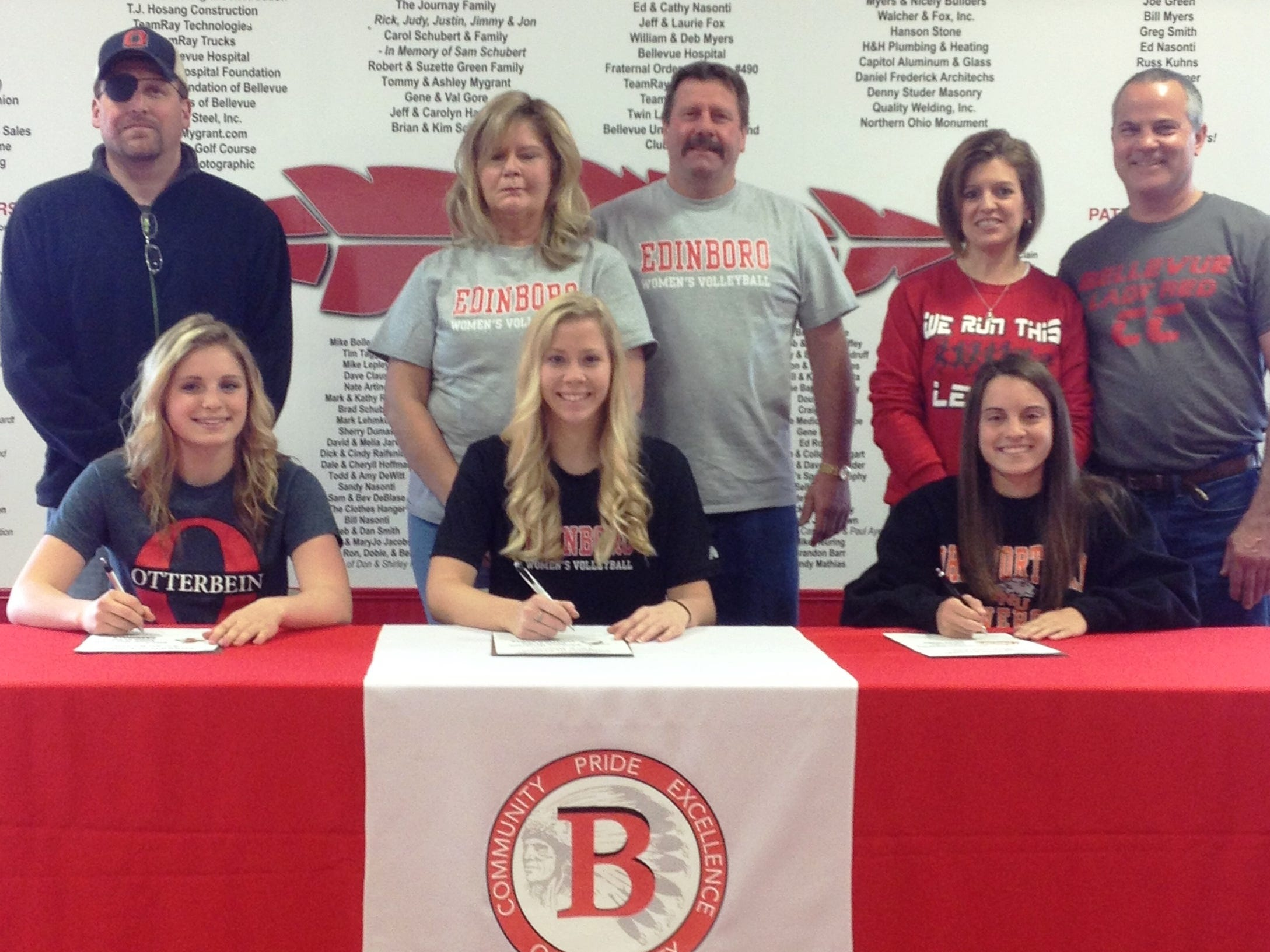 Bellevue High School seniors Sarah Bedell (front row, left) Tare Rinner (front center) and Michaela Fox (front right) sign to continue their athletic careers at the collegiate level Thursday. Bedell will run track at Otterbein University, Rinner will play volleyball at Edinboro University of Pennsylvania and Fox will run cross county at Ohio Northern. Submitted photo