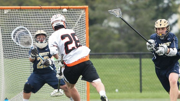 Palmyra's Blaise Amelio takes a shot during the Cougars' 15-2 win over Bishop McDevitt at In the Net on Thursday.