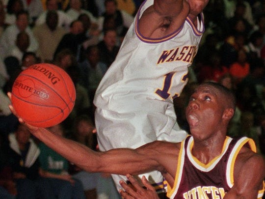 Milwaukee Vincent's Robert Yanders flips a shot under Washington High School's Marion Grice to score Dec. 5, 1997.
