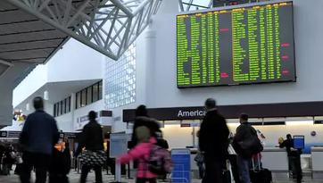 Travelers make their way through Nashville International Airport on Jan. 8.
