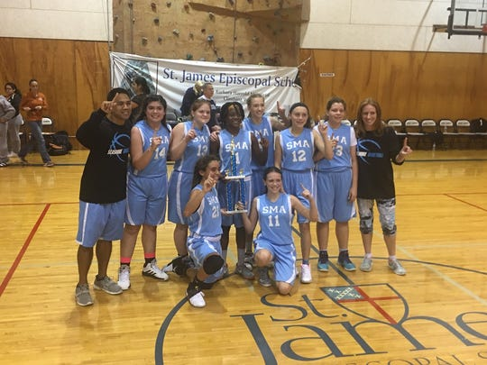 The Seashore Middle School Academy girls basketball team won a tournament at St. James Episcopal School in November. Top row, coach Randy Corpuz, from left, Emily Cosio, Alexia Hisaw, Ny Crowelle, Kennedy Orzechowski, Kennedy Dugan, Megan May, coach Amanda Corpuz; bottom row, Bella Bertero and Emily Clark. Not pictured Aliyah Welker.