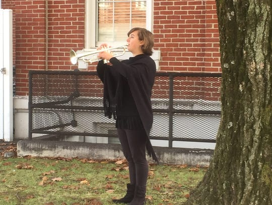 Lilli Butler, 16, played taps for the UC Veterans'