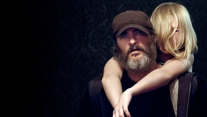 """Joaquin Phoenix is weird and has a beard in """"You Were Never Really Here,"""" which opens Friday at the Ridgeway."""