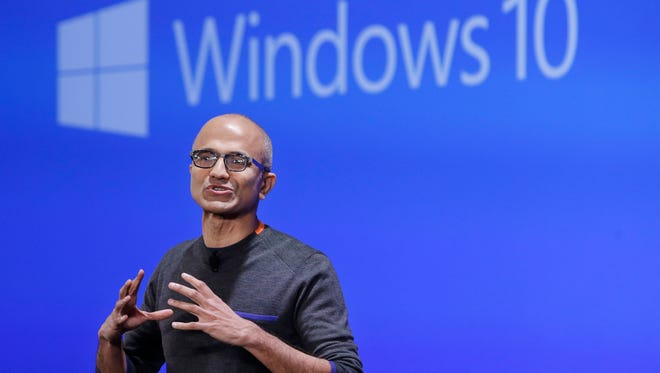 Microsoft CEO Satya Nadella speaks at an event last year demonstrating the new features of Windows 10 at the company's headquarters. Executives demonstrated how they said the new Windows is designed to provide a more consistent experience and a common platform for software apps on different devices, from personal computers to tablets, smartphones and even the company's Xbox gaming console.