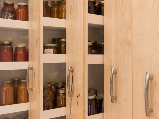 Pull-out shelves allow easy access to everything stored