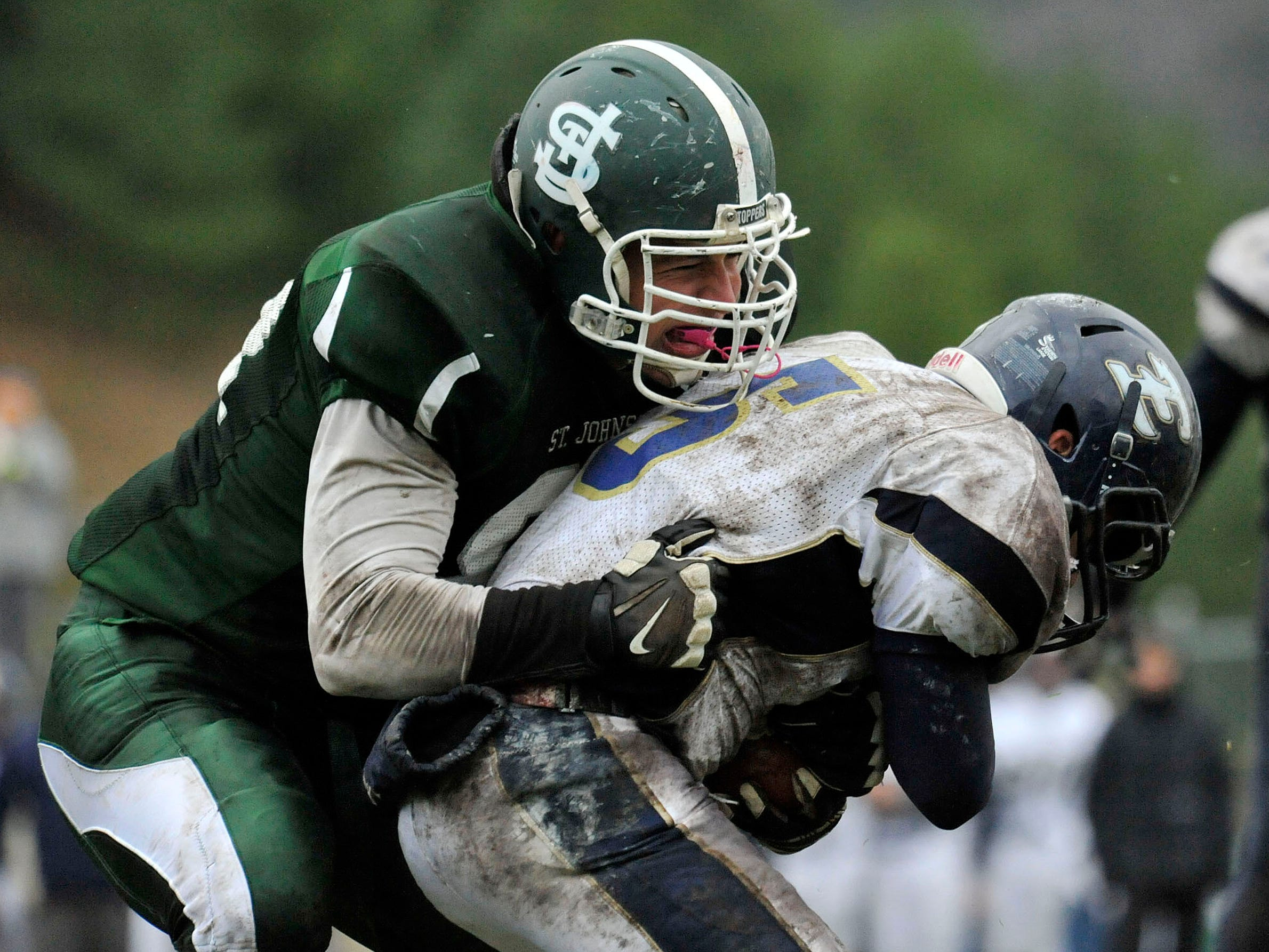 St. Johnsbury's Carlos Carrasco sends Essex runner Joey Robertson for a loss during the Hiltoppers' 26-6 win in last week's Division I semifinal.