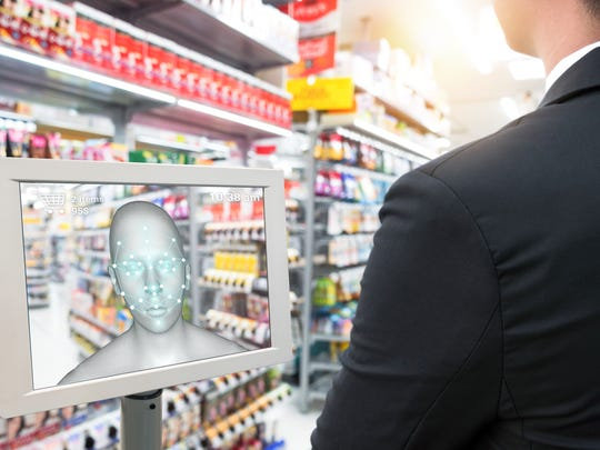 A shopper pays with a facial-recognition tablet.
