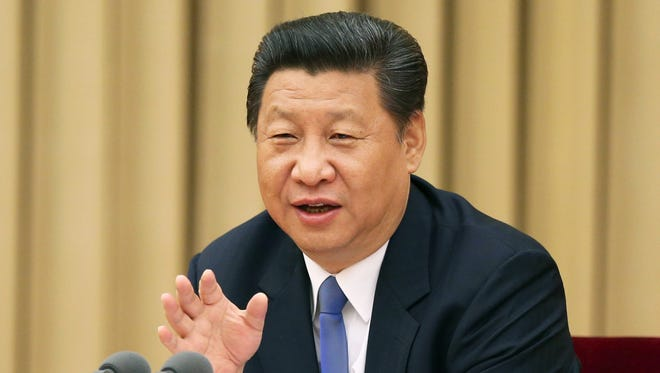 In this photo released by China's Xinhua News Agency,  Chinese President Xi Jinping addresses a high-level party meeting.