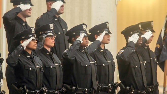 Members of the 97th Wilmington Police Academy Graduating class salutes during ceremony Thursday, Feb. 10, 2017, at Chase Center On The Riverfront in Wilmington Delaware.