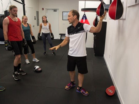 Billy Lyell teaches an adult group fitness class at