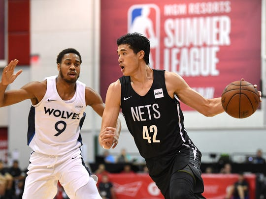 Brooklyn Nets forward Yuta Watanabe (42) dribbles away from Minnesota Timberwolves guard Isaiah Cousins (9) during the first half at Cox Pavilion.