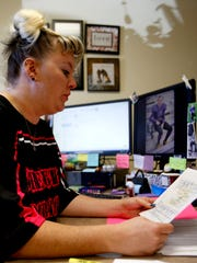 Lower Valley Senior Center Director Michelle Murray on Tuesday looks through the paperwork for a grant that would help the center located in Fruitland.