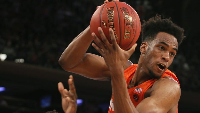 Syracuse forward Oshae Brissett grabs a rebound from Connecticut forward Mamadou Diarra in the first half of the Jimmy V Classic Tuesday at Madison Square Garden.