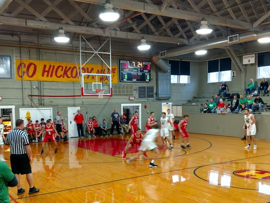 """The Clear Fork and Loudonville varsity basketball teams scrimmage Nov. 18 in the Hoosier Gym, made famous by the film classic """"Hoosiers."""""""