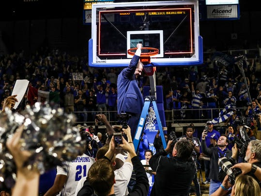 Middle Tennessee coach Kermit Davis cuts down the net after MTSU's 82-64 win over Western Kentucky in an NCAA college basketball game Thursday, March 1, 2018, in Murfreesboro, Tenn. Middle Tennessee clinched the Conference USA title.  (Austin Anthony/Daily News via AP)