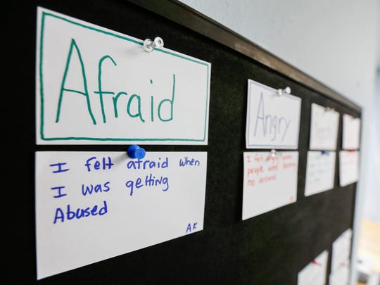 A victim's example of when they felt afraid is pinned to a board at the Victim Center.