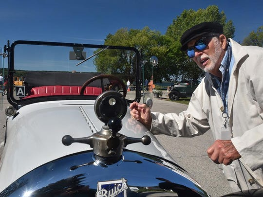 Frank Heidler of Sister Bay looks over the uniquely mounted temperature gauge on the hood his 1923 Buick Phaeton during last year's concours d'elegance at the Ephraim Hill Climb.