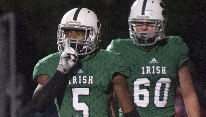 Camden Catholic running back Nazir Streater motions to his bench after scoring in the fourth quarter of Friday's 30-7 win over Cherry Hill West in a matchup of unbeaten teams.