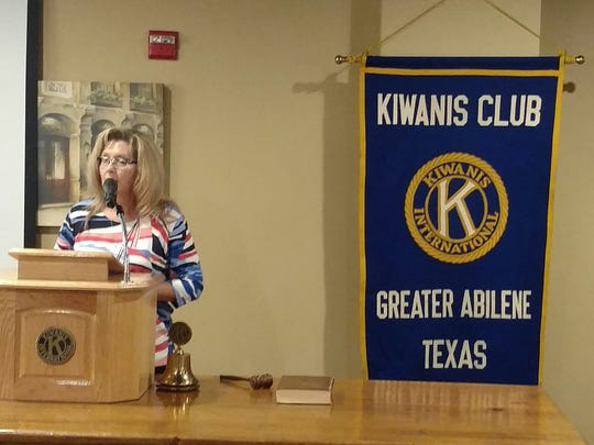 Rochelle Johnson, of the Taylor County Expo Center, speaks to the Kiwanis Club of Greater Abilene about the center's development and economic impact.