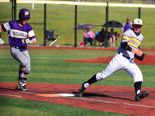 Southeast Polk pitcher Brayden Shepherd (9) tags Indianola's  Scout Dishman (5) out at first Thursday during a baseball game between the Southeast Polk Rams and the Indianola Indians at Southeast Polk High School.