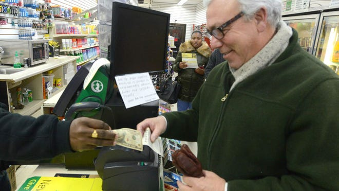 Richard Lowe of Teaneck buying Powerball tickets at Rocklin's in Teaneck on Tuesday, Jan. 12, 2016.