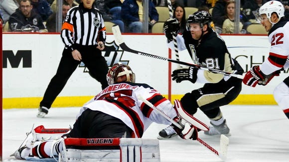 The Penguins' Phil Kessel (81) beats New Jersey Devils' Jordin Tootoo (22) and goalie Cory Schneider (35) for a goal during the second period in Pittsburgh, Tuesday.