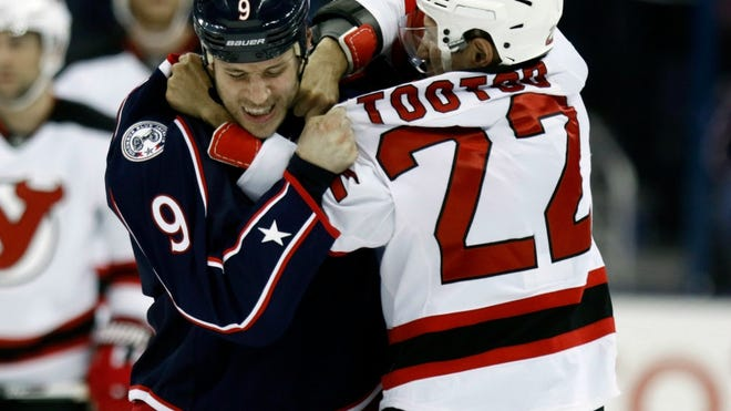 Columbus Blue Jackets' Gregory Campbell, left, and New Jersey Devils' Jordin Tootoo fight during the first period in Columbus, Ohio, Thursday, Feb. 25, 2016.