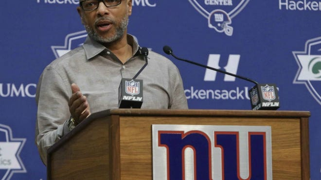 Giants general manager Jerry Reese responds to a question during a news conference.