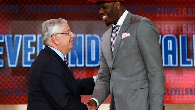 In this June 27, 2013 file photo, NBA Commissioner David Stern, left, shakes hands with UNLV's Anthony Bennett, who was selected first overall by the Cleveland Cavaliers in the NBA basketball draft in New York. (AP Photo/Jason DeCrow)