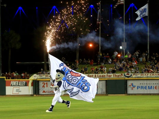Hooks' mascot Rusty the Hook waves a flag after they defeat Arkansas on Friday, April 14, 2017, at Whataburger Field in Corpus Christi.