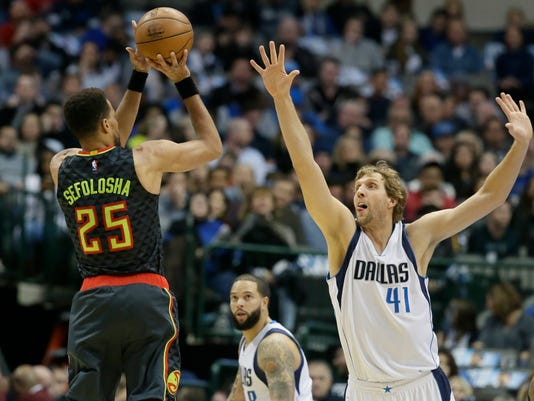 Dallas Mavericks forward Dirk Nowitzki (41) of Germany challenges the shot by Atlanta Hawks forward Thabo Sefolosha (25) during the first half of an NBA basketball game in Dallas, Saturday, Jan. 7, 2017. (AP Photo/LM Otero)
