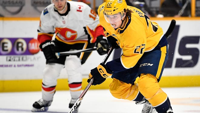 Nashville Predators left wing Kevin Fiala (22) advances against the Calgary Flames during the first period at Bridgestone Arena in Nashville, Tenn., Tuesday, Oct. 24, 2017.