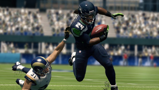 Seattle Seahawks running back Marshawn Lynch escapes a St. Louis Rams defender in 'Madden NFL 25.'