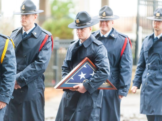 Officers arrive to the funeral of fallen New Jersey