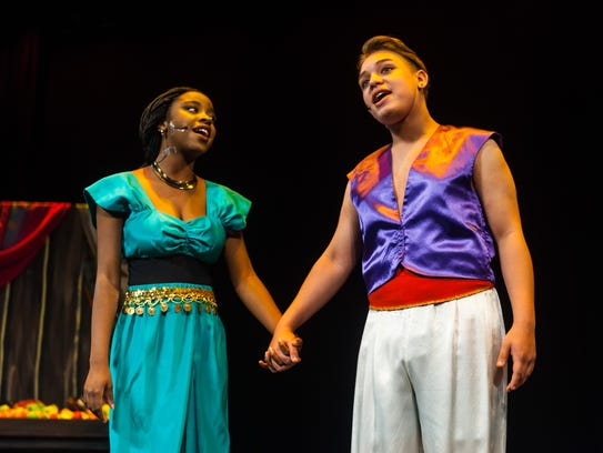 Jasmine, played by Tofunmi Ayeni, and Aladdin, played