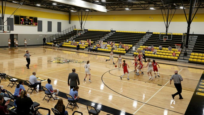 Haven and Trinity Catholic girls basketball teams play their first game of the season at Haven Friday night, Dec. 4, 2020. The stands were empty other than  cutouts of people placed in the stands to show support for the teams and as part of a prom fundraiser.