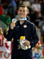 Steven Gluckstein of the United States celebrates on the podium after he won the silver medal in the men's individual trampoline gymnastics final on Day 9 of the Toronto 2015 Pan Am Games on July 19, 2015 in Toronto, Canada.