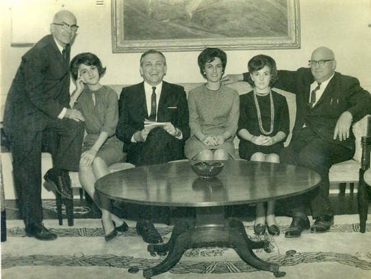 Left to right:  L.L. Robinson with his daughters, Rita