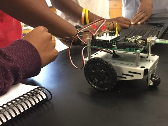 A group of students at Wossman High School work on a Boe-Bot as part of a science and technology class on Oct. 11.