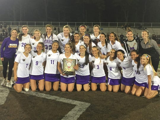The Monroe girls lacrosse team won its second-straight GMC Tournament title with a double overtime 7-6 victory over South Brunswick on Friday, May 11, 2018 at East Brunswick.
