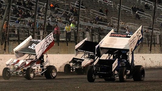 ASCS sprint car drivers compete in the Lucas Oil ASCS feature event at during the Port-A-Cool U.S. National Dirt Track Championship at Texas Motor Speedway on Sept. 13, 2014 in Fort Worth, Texas.