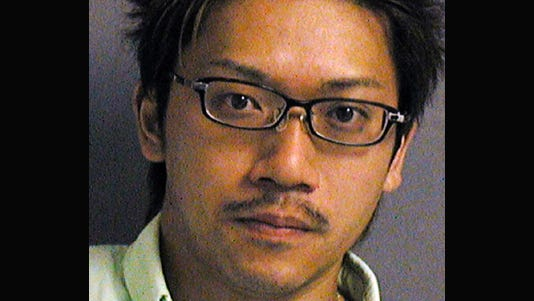 A photo provided by the U.S. Attorney's Office in Honolulu shows Kenji Okamoto.