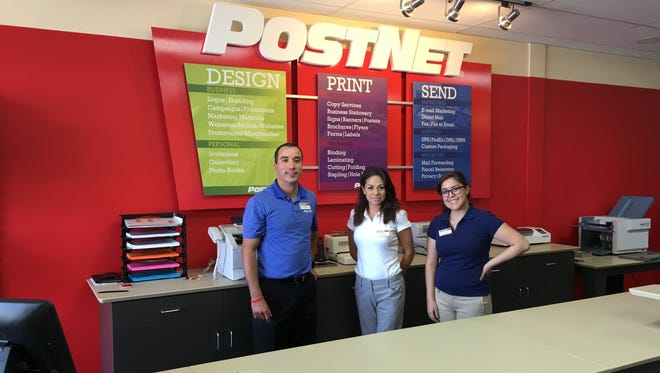 El Paso businessman Javier Ferrer and employees Beatrice Flores, middle, and Laura Aponte at Ferrer's new PostNet center franchise in the Shops at Dieter Village in East El Paso.