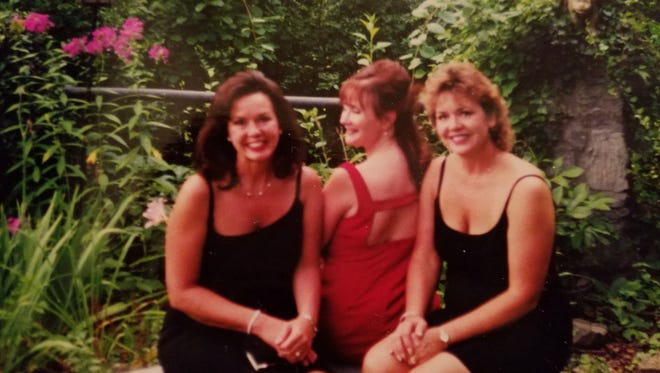 Penny Carney Bevilaqua, Jeannie Johnson and Pamela Carney Read at a class reunion.